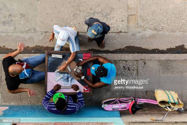 Overhead view of men playing dominoes on Camaguey street, Camaguey, Cuba