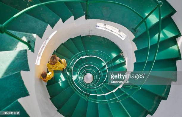 Overhead view of mother and son on spiral staircase, Tavares, Rio Grande do Sul, Brazil, South America