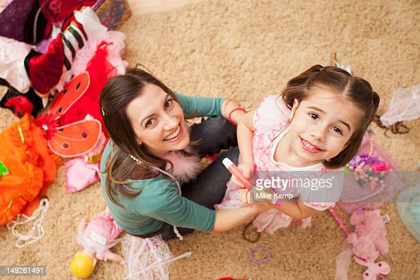 overhead view of mother with her daughter (4-5) in fancy dress costume - boa stock pictures, royalty-free photos & images