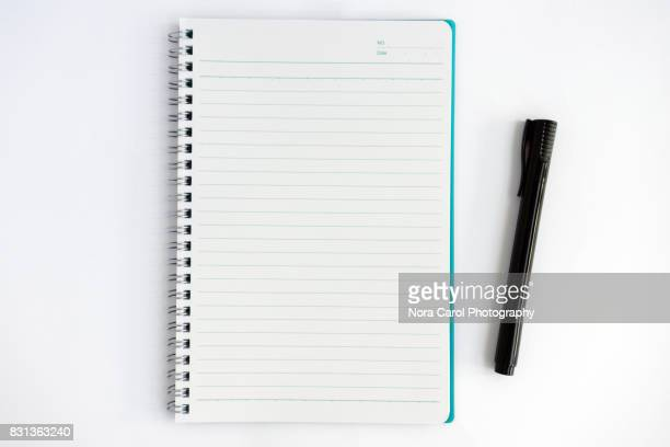 overhead view of note pad and pen - stift stock-fotos und bilder