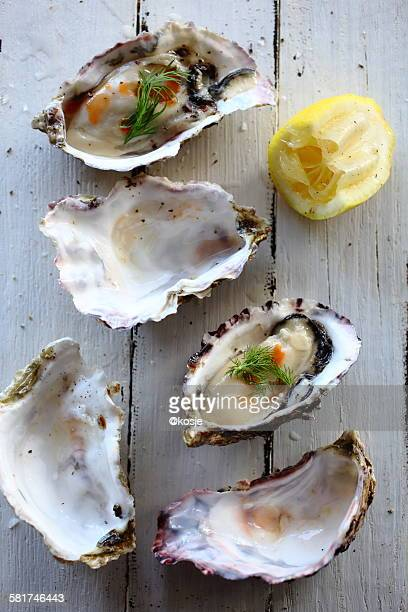 Overhead view of oysters and lemon