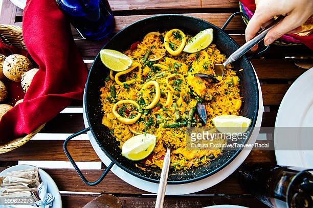 Overhead view of paella at restaurant table, Tulum, Riviera Maya, Mexico
