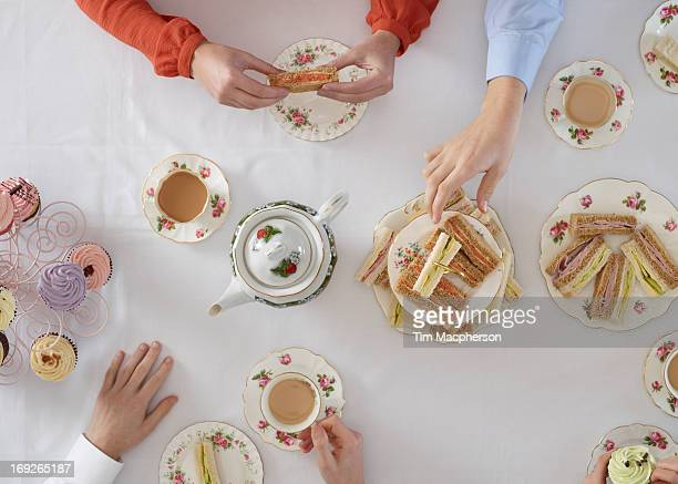 Overhead view of people having tea