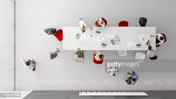 overhead view of people in the office - red stock pictures, royalty-free photos & images