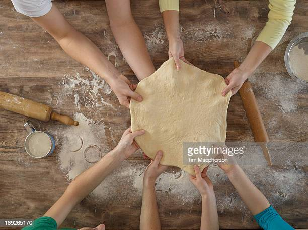 Overhead view of people making bread