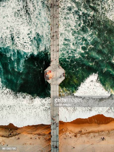 overhead view of people on pier at huntington beach - huntington beach stock pictures, royalty-free photos & images