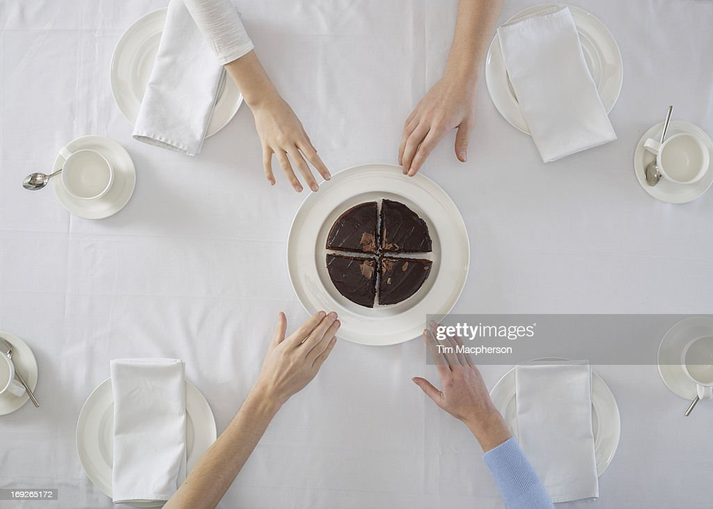 Overhead view of people sharing dessert : Stock Photo