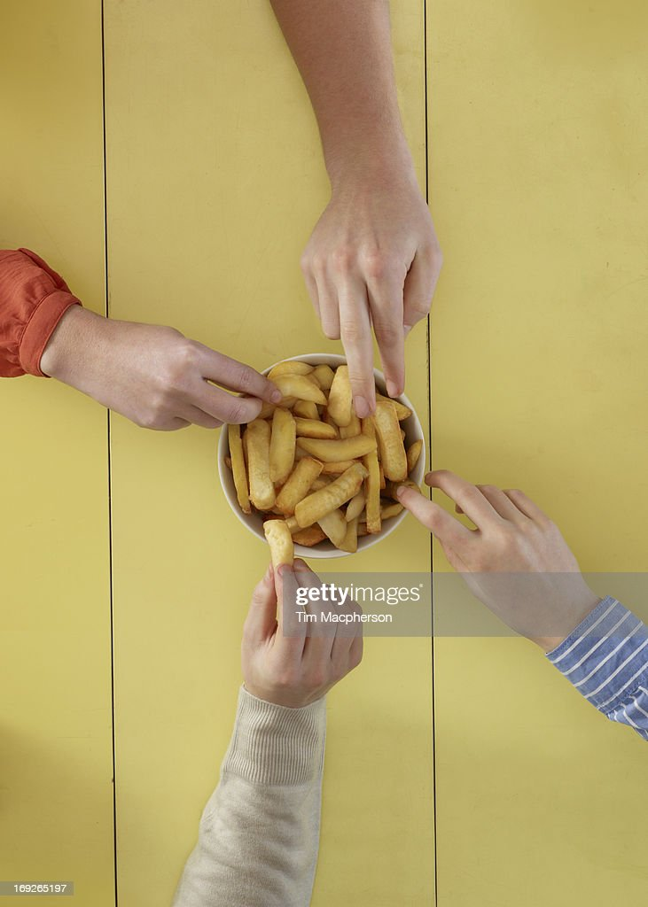 Overhead view of people sharing fries : Stock Photo