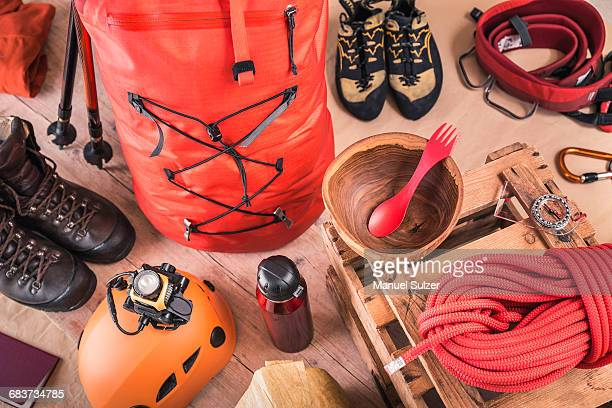 Overhead view of prepared climbing equipment with rucksack, climbing boots and climbing rope
