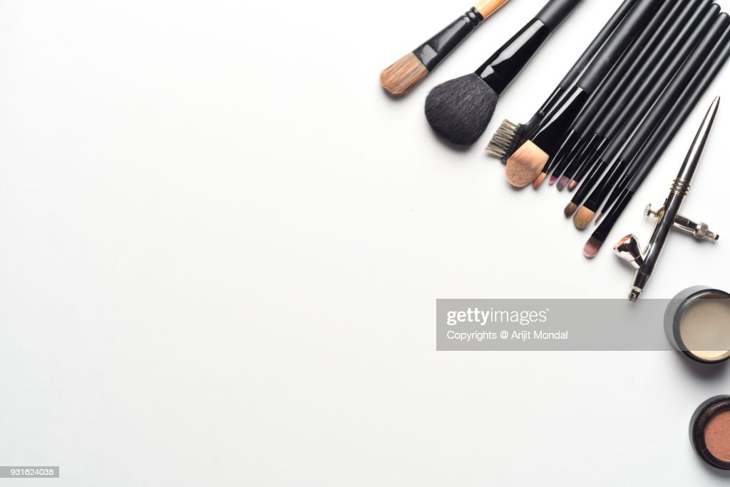 Overhead View Of Professional Airbrush Makeup Kit With Makeup Brushes On White Background Copy Space :