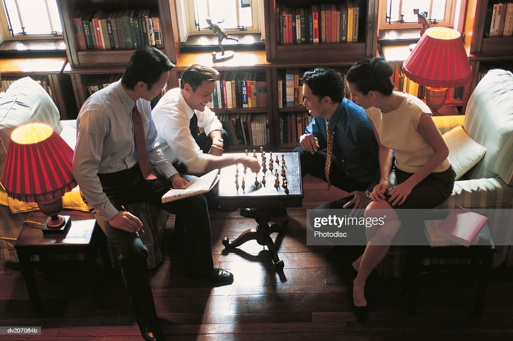 Overhead view of professionals playing chess : Stock Photo