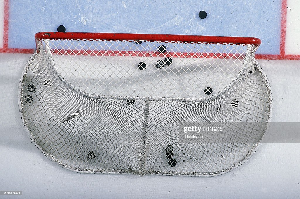 Pucks In The Goal : News Photo