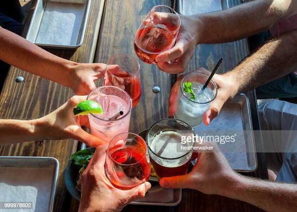 overhead view of six people making a celebratory toast - cocktail stock pictures, royalty-free photos & images