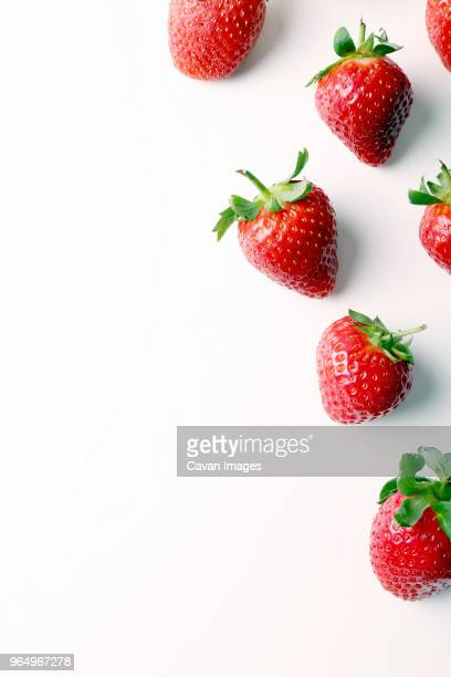 overhead view of strawberries over white background - strawberry stock pictures, royalty-free photos & images