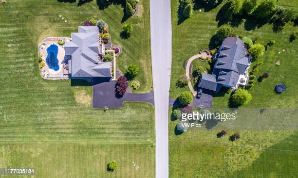 Overhead view of suburban homes with neatly manicured lawns