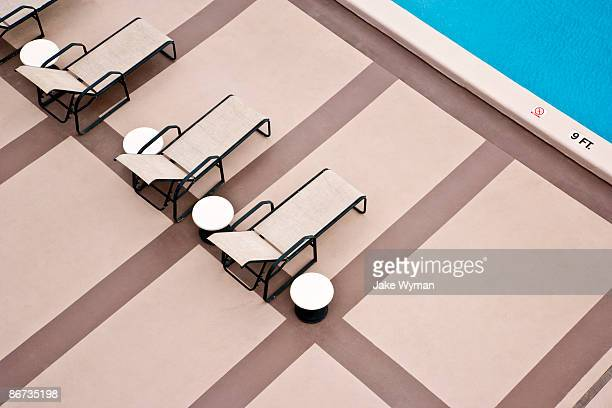 overhead view of swimming pool - sun lounger stock pictures, royalty-free photos & images