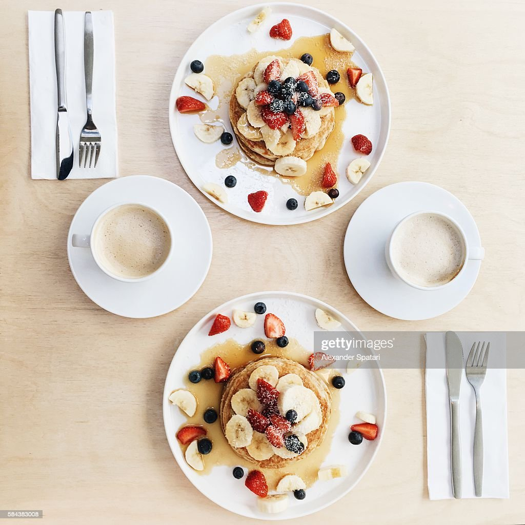 Overhead View Of Symmetric Breakfast For Two Persons With Pancakes And Coffee High Res Stock Photo Getty Images