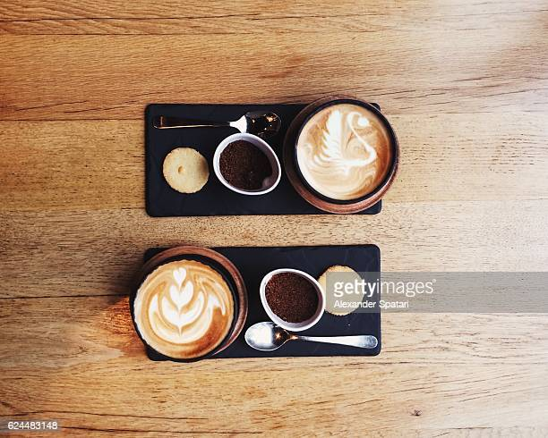 Overhead view of symmetric coffee cups for two persons