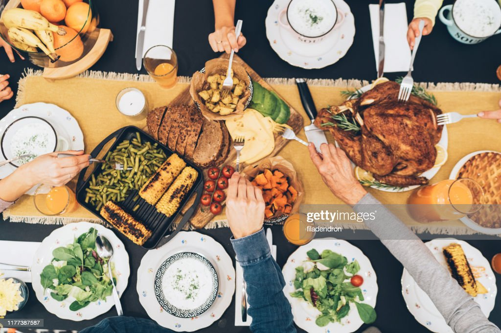 Overhead view of table during Christmas dinner : Stock Photo