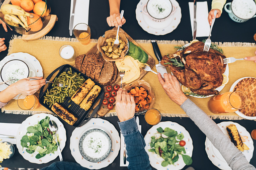 Overhead view of table during Christmas dinner 1177387587