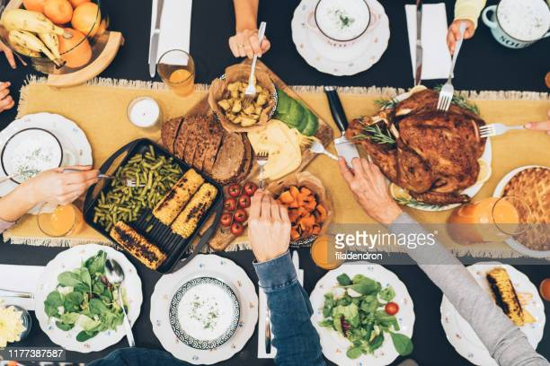 overhead view of table during christmas dinner - thanksgiving holiday stock pictures, royalty-free photos & images