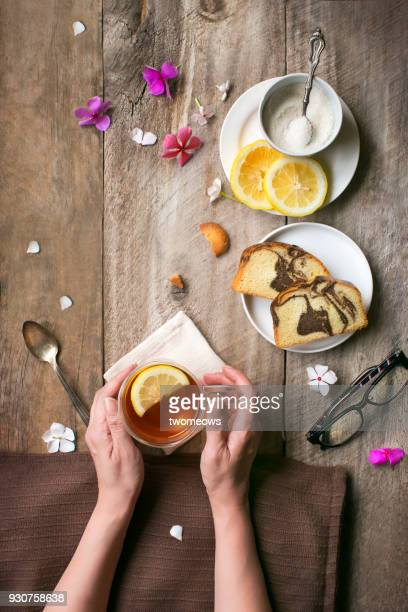 Overhead view of tea break food and drink table top image.