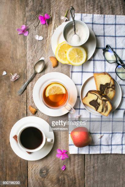 overhead view of tea break food and drink table top image. - afternoon tea stock pictures, royalty-free photos & images