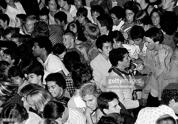 Overhead view of the crowded floor as fans attend a performance at the Whisky a Go Go night club Los Angeles California late 1970s or early 1980s...