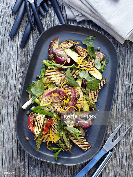 Overhead view of vegetable salad on barbecue griddle pan