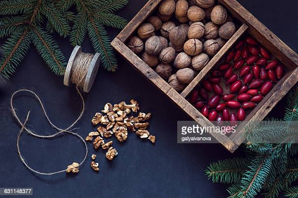Overhead view of Walnuts and rosehip in a wooden crate