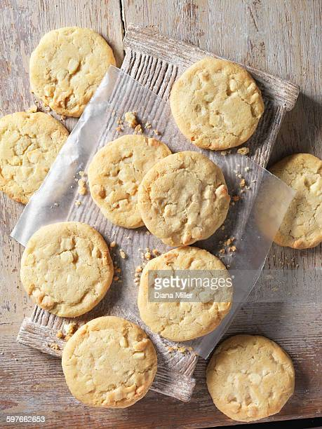 overhead view of white chocolate chunk cookies on wood - white chocolate stock photos and pictures