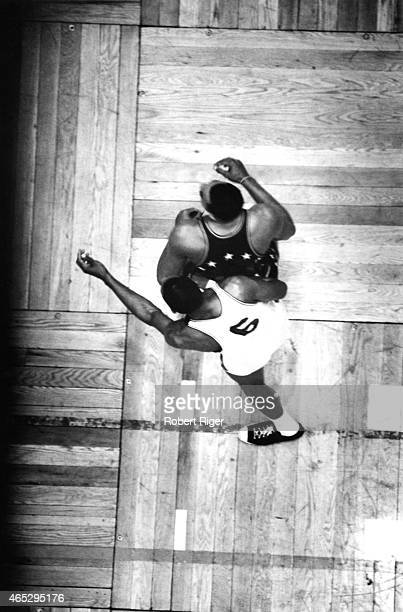 Overhead view of Wilt Chamberlain of the Philadelphia 76ers as he battles for position with Bill Russell of the Boston Celtics on the parquet floor...