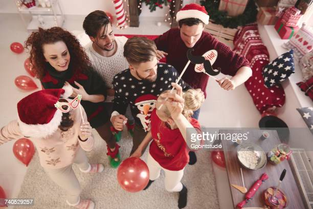 Overhead view of young adult friends dancing at christmas party