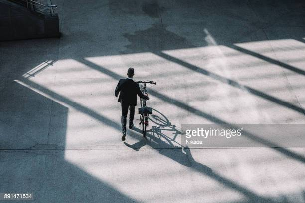 overhead view on Businessman with bicycle