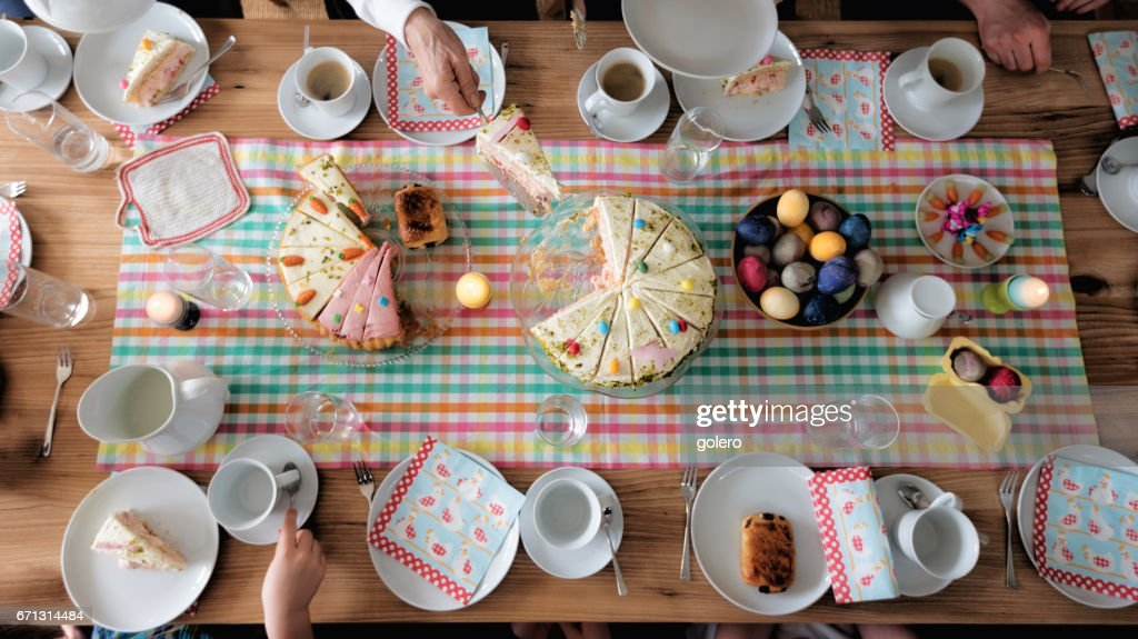 overhead view on easter table with family around : Stock Photo
