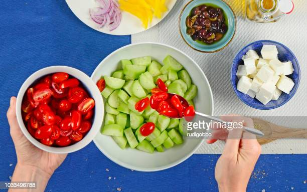 overhead vision of making greek salad - feta cheese stock pictures, royalty-free photos & images