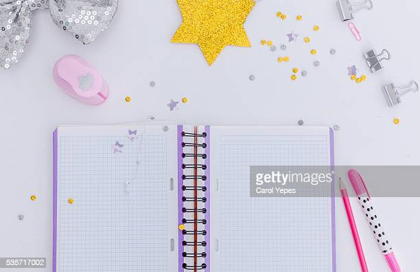 overhead  white notebook and some school/child items around