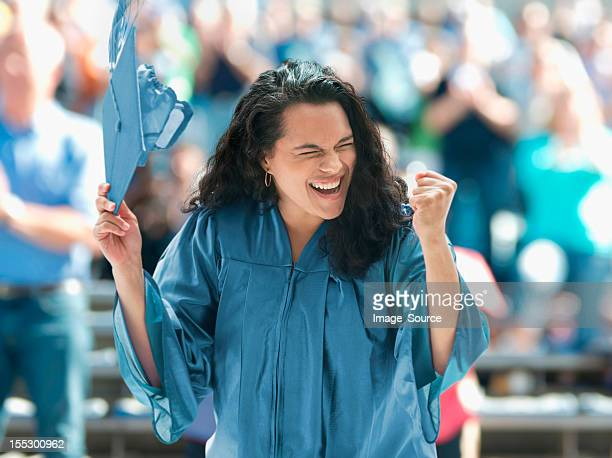 overjoyed female graduate - graduation crowd stock pictures, royalty-free photos & images
