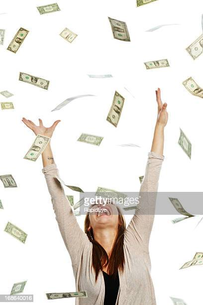 Overjoyed woman catching shower of falling banknotes