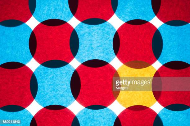 overlapping circle paper pattern - individuality stock photos and pictures