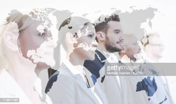 Overlay Of World Map On Portrait Of Business People