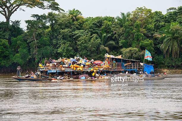 overloaded barge (vessel) on the congo river - democratic republic of the congo stock photos and pictures