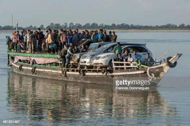 CONTENT] Overloaded ferries carry passengers bikes cars as well as different kinds of goods and animals across the Brahmaputra river crossing South...