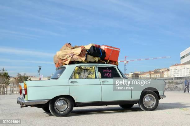 Overloaded Peugeot 404 Marseille