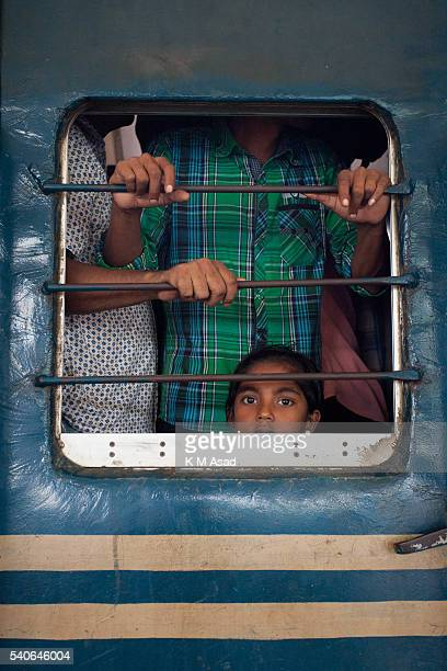 Overloaded train with people who are ready to travel to their villages by train in Dhaka Bangladesh July 16 2015 Millions of Bangladeshis are...