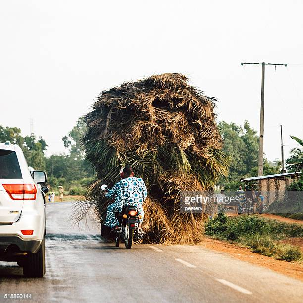 Overloaded vehicle on African roads. Benin.