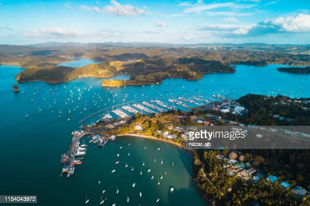 overlooking bay of islands, with ferry terminal to new zealand. - northland new zealand stock pictures, royalty-free photos & images