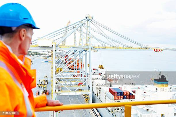 overlooking his dockyard - longshoremen stock pictures, royalty-free photos & images