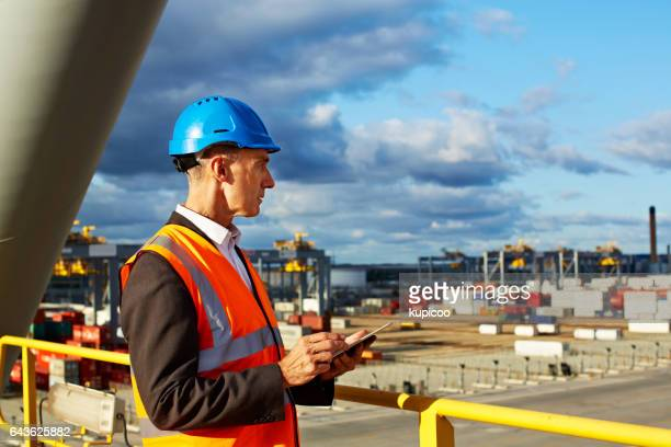overlooking his harbour - longshoremen stock pictures, royalty-free photos & images