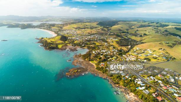 overlooking long stretch of cable bay and coopers beach, northland, new zealand. - northland new zealand stock pictures, royalty-free photos & images